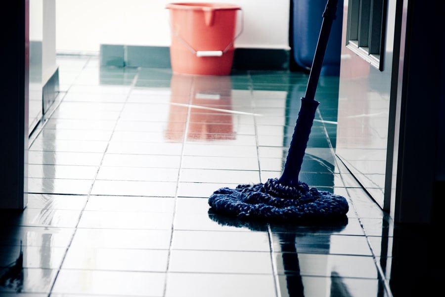 dangerous wet floor with mop and bucket