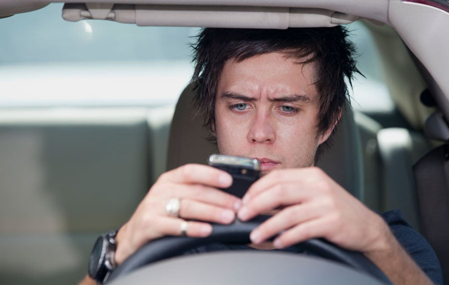 distracted driver texting on phone