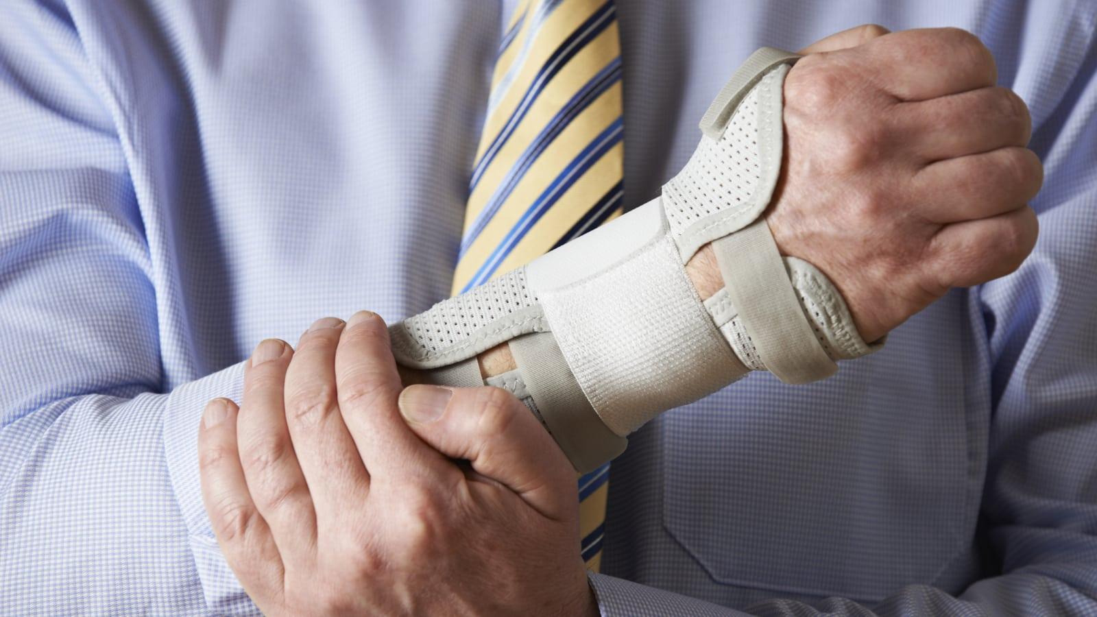 Businessman Suffering With Repetitive Strain Injury